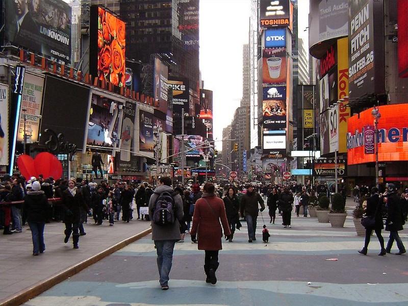 People walking around on Broadway in New York.