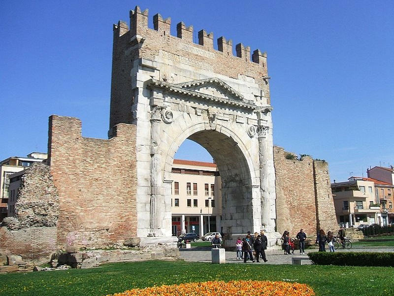Image of Arch of Augustus on a sunny day in Rimini, Italy.