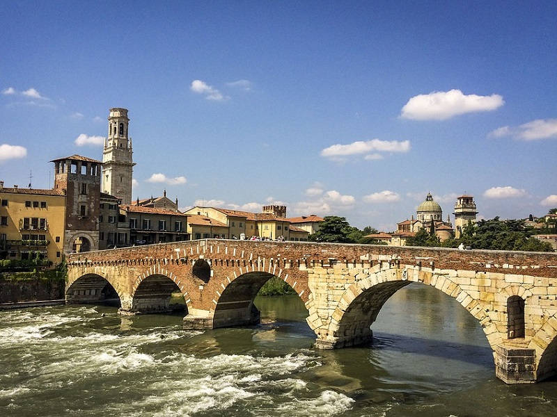 A picture of Verona River streaming under the Stone Bridge.